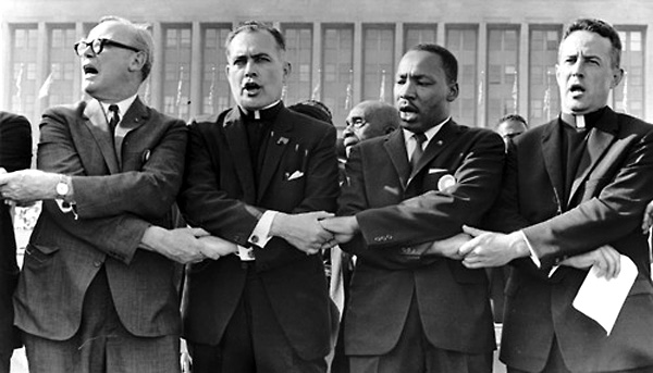 Holy Cross Father Theodore Hesburgh, second from left, and the Rev. Martin Luther King Jr. participate in a June 21, 1964, rally at Chicago's Soldier Field. This photo of Father Hesburgh and Rev. King will become a part of the permanent collection of the National Portrait Gallery in Washington. (CNS photo/National Portrait Gallery) (Oct. 10, 2007) See HESBURGH Oct. 10, 2007.