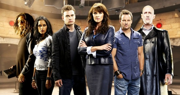 SANCTUARY -- Pictured: (l-r) Agam Darshi as Kate Freelander, Robin Dunne as Dr. Will Zimmerman, Amanda Tapping as Dr. Helen Magnus, Ryan Robbins as Henry -- Syfy Photo: Pete Tangen